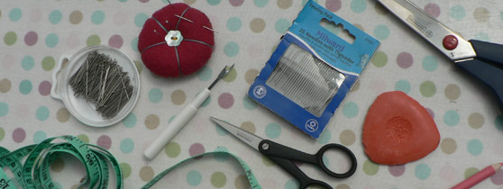 basic dressmaking equipment - pins, needles, scissors, tape measure and chalk