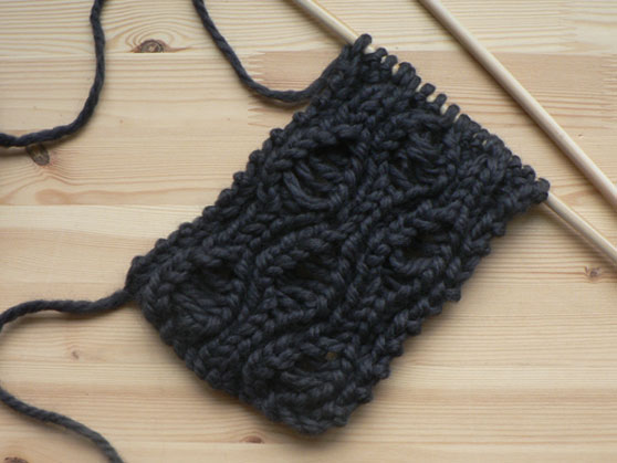 drop-stitch scarf on knitting needles