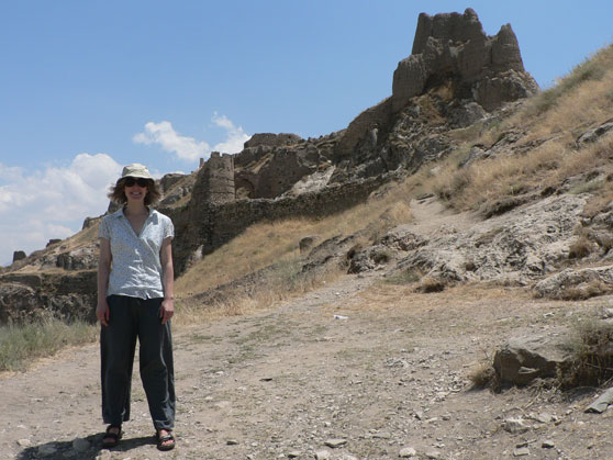 Me looking like a dork, standing next to the fortress on the Rock of Van