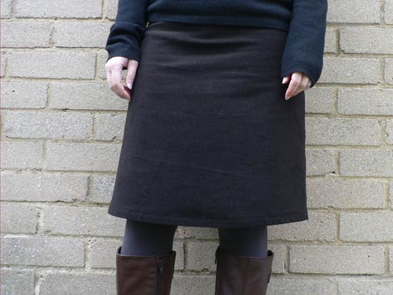 Me standing against a wall modelling the new winter skirt