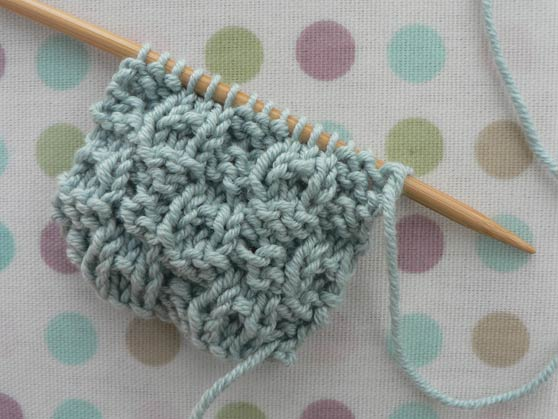 Sample of dimple knitting stitch in pale-blue cotton yarn