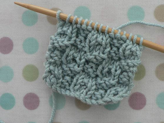 Reverse of sample of dimple knitting stitch on needle