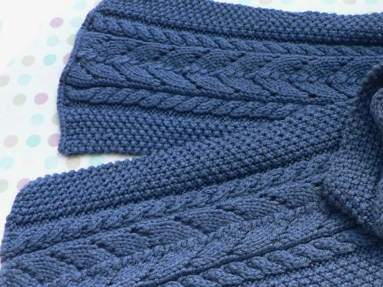 Knitted scarf in blue wool