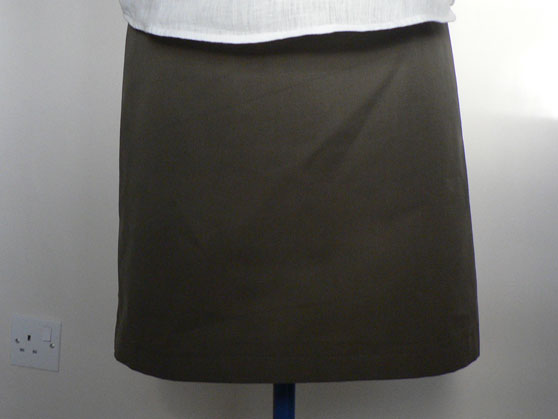 Olive-green a-line skirt on dressmakers dummy