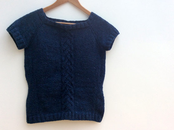 blue knitted short-sleeve top on hanger