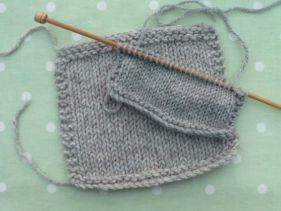 knitted swatches to compare New Lanark chunky and Alaska Drops