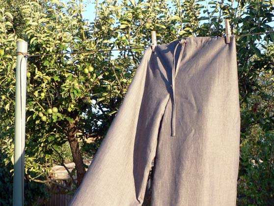 grey chambray cotton drawstring trousers hanging on washing line